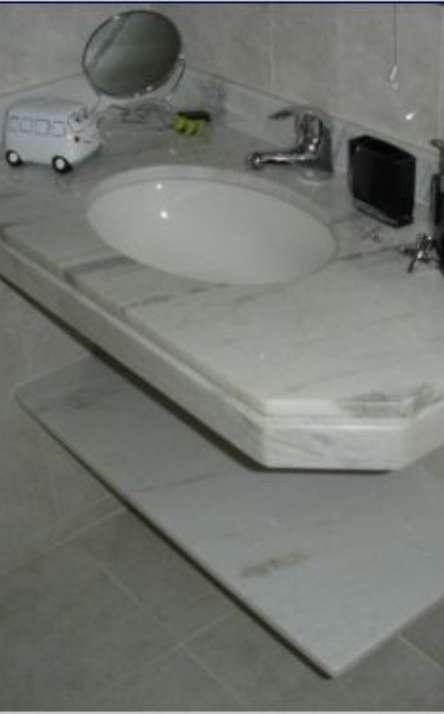 Banheiros em granito e mármore - Foto: 22